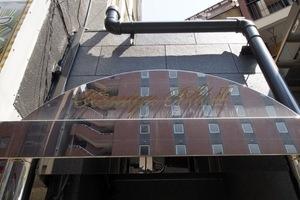 大塚カベタビルの看板